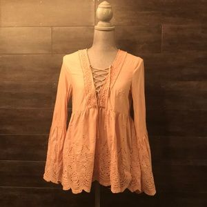 Light pink bell sleeve eyelet embroidered top